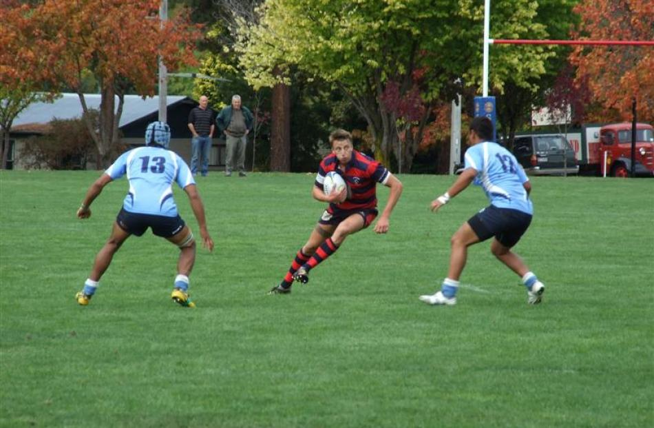 Arrowtown's Laurence Wadham tries to get past Roxburgh's defence. Photos by Christina McDonald.
