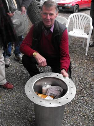 Arrowtown Ward councillor Lex Perkins was given the honour of burying the time capsule near the...