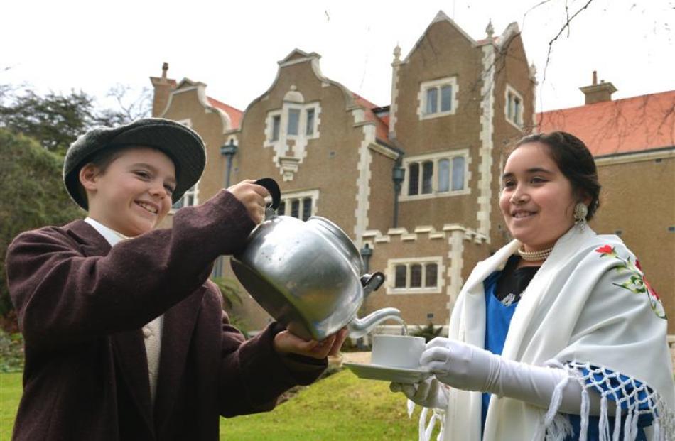 Arthur Street School pupils Flynn Ellison and Olivia Sefo share some tea in the garden at...