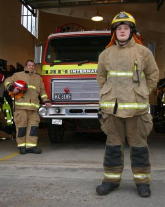 Ashley Diamond ready for action at the Tapanui Volunteer Fire Brigade's station. With him is his...