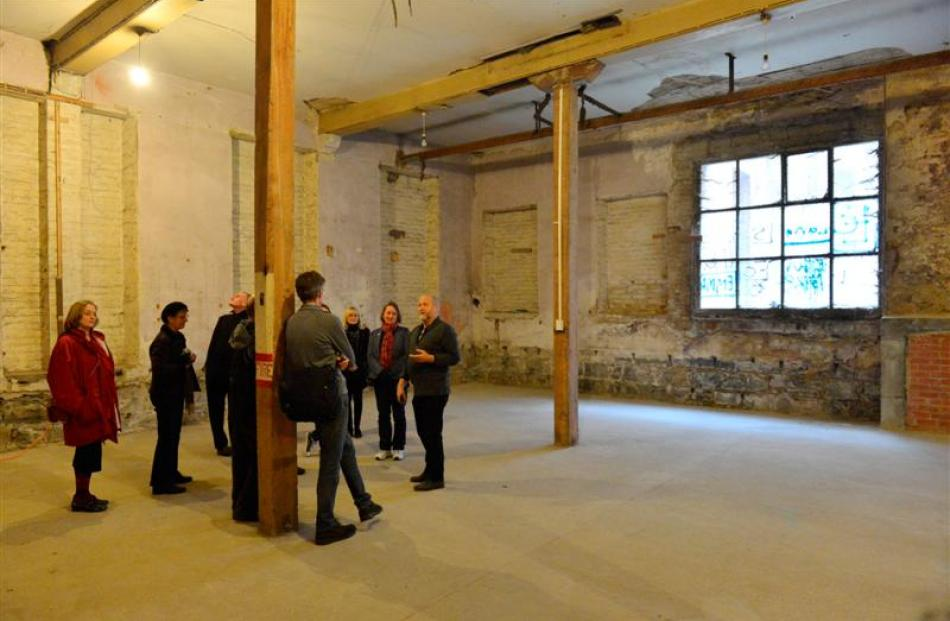 Athenaeum tour guide Allan Baddock shows a tour group yesterday the underground space ''screaming...