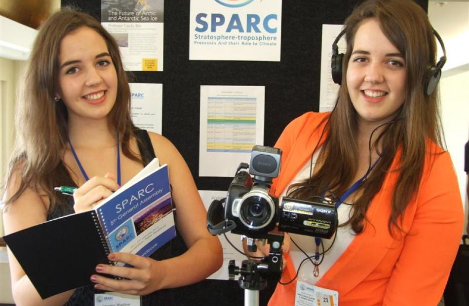 Australian twins Imogen (left) and Freya Wadlow have been decoding climate science talks in...