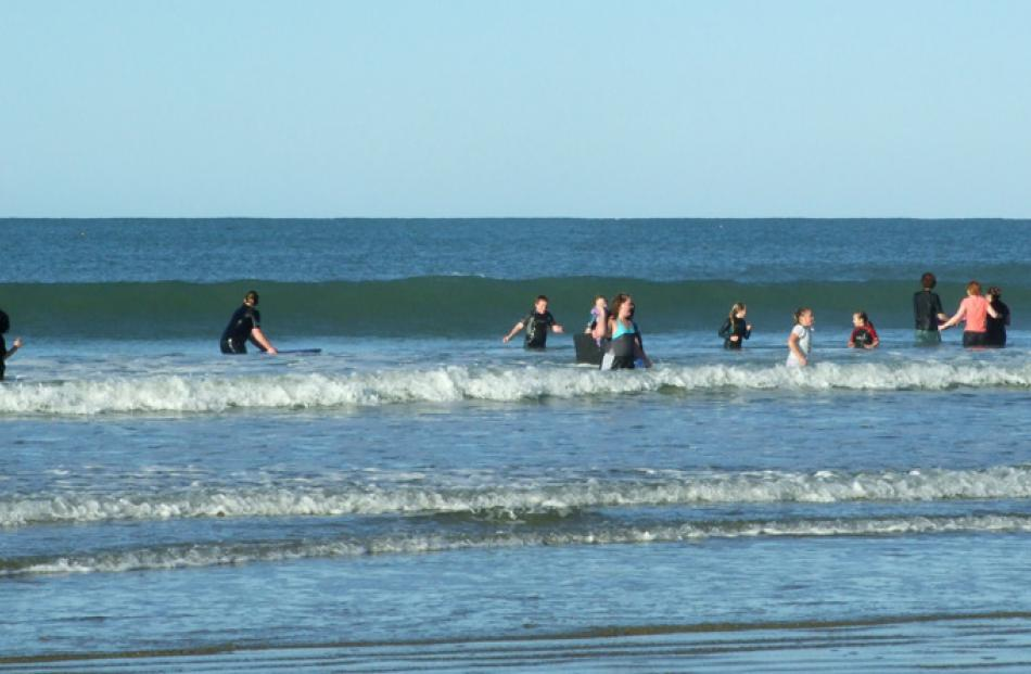 Some of 40 brave souls who took part in the annual midwinter swim at Kaka Point yesterday.