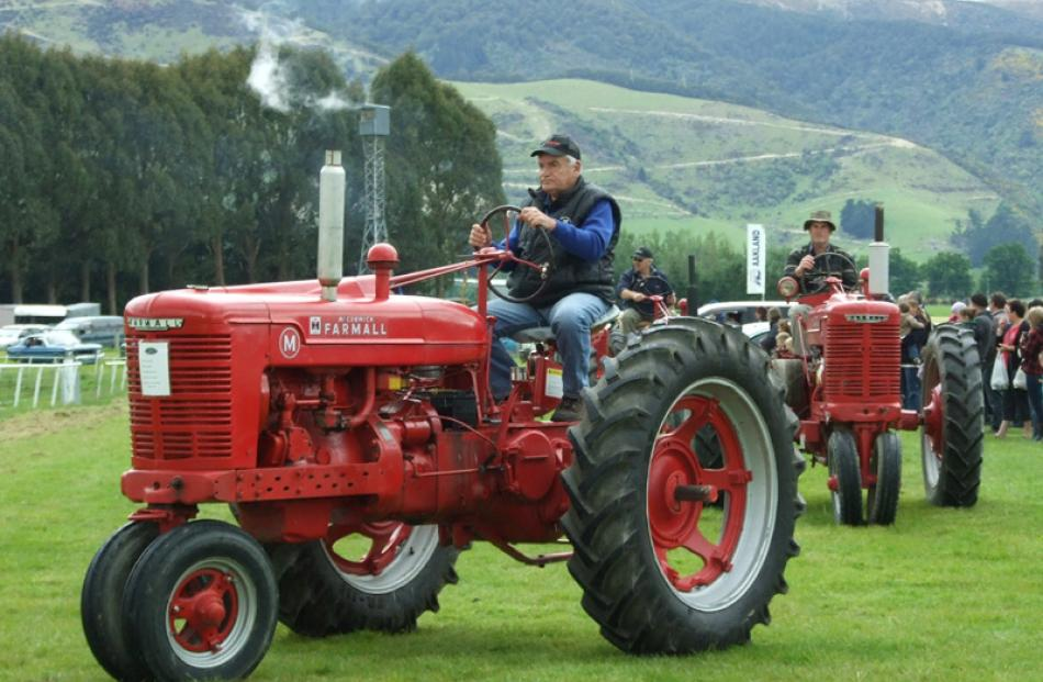 Scottie Birse, of Tapanui, leads a group of vintage Farmall tractors.