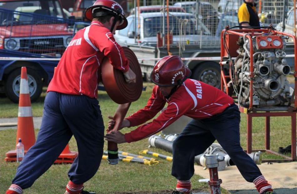 Balclutha team members Jason Watt (left) and Craig Botting compete in the Otago-Southland fire...