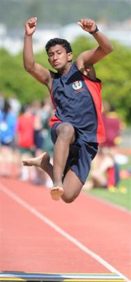 Click to enlarge photos. Balmacewen Intermediate's Vimukthi Aruma (13) competes in the long jump.