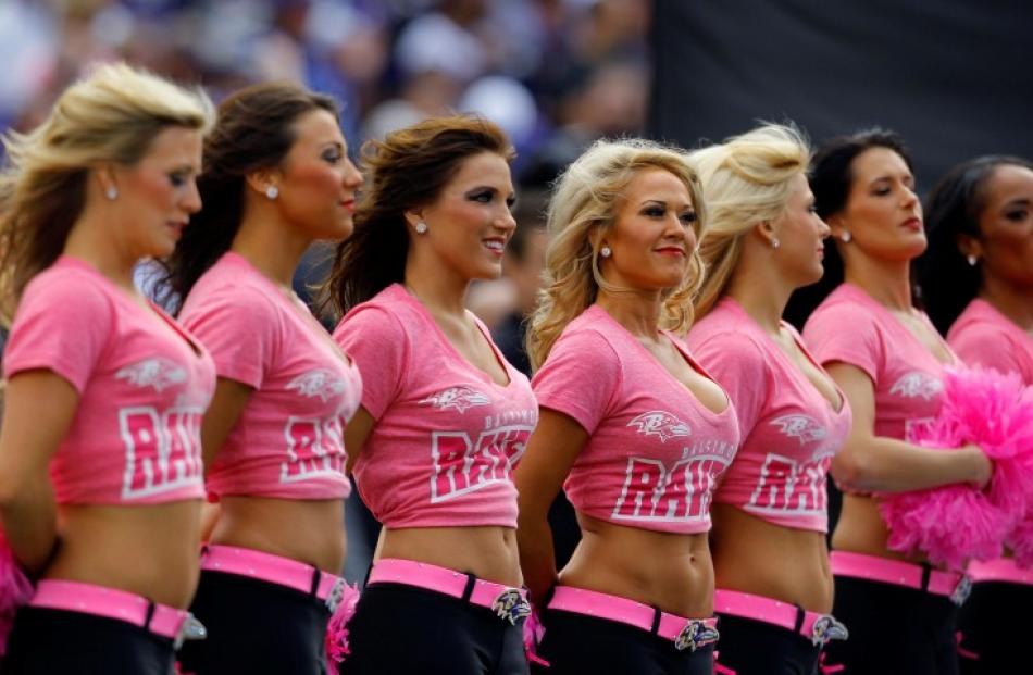 Baltimore Ravens cheerleaders are seen in their pink breast cancer awareness shirts before the...