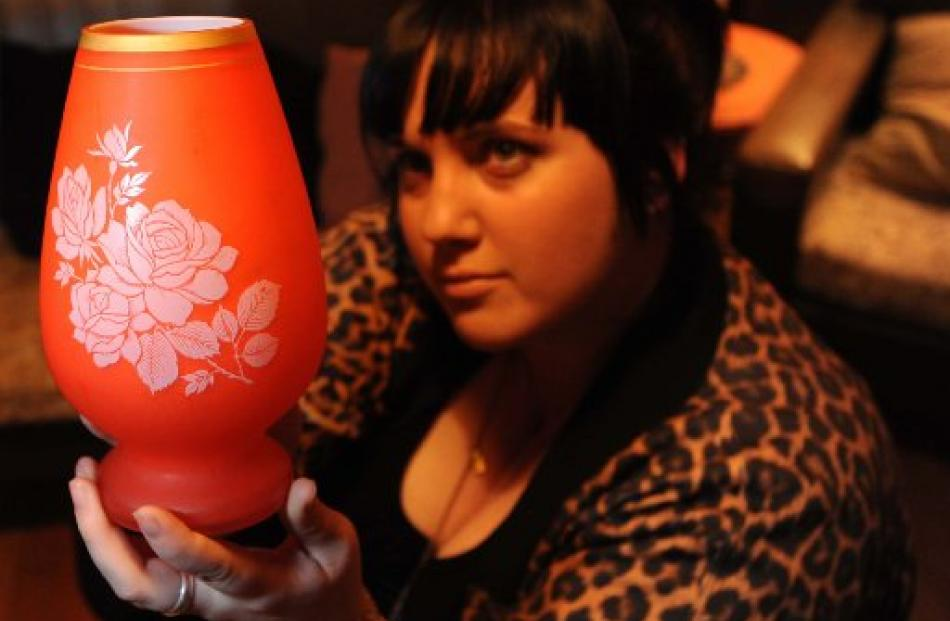 Bargain hunter Emily Cannan with a frosted-glass vase, bought for $3 when she was a teenager....