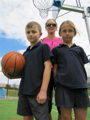Basketballers Romili (10) and Niamh (8) Townsend and their mother Hayley Kyle  favour new indoor...