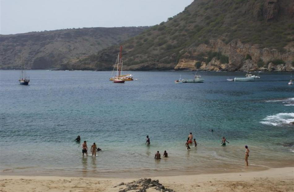 Bathers enjoy the  beach at Tarrafal.