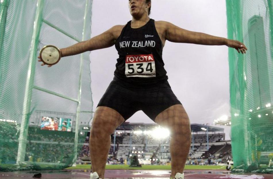 Beatrice Faumuina competes in the women's discus final at the world athletics championships in...
