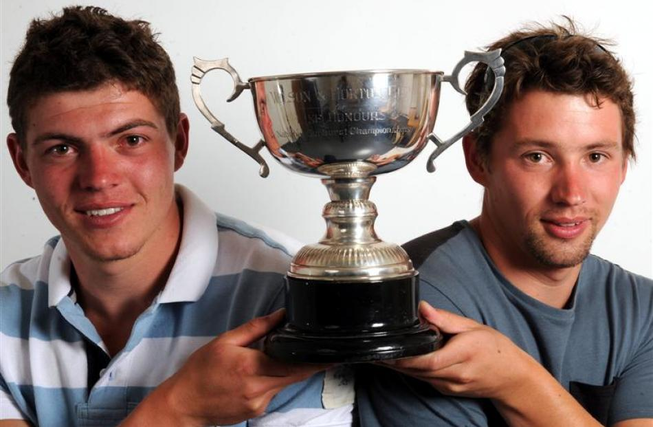 Ben (left) and Jake Hawker with the New Zealand Sunburst yachting trophy they won on  Otago...