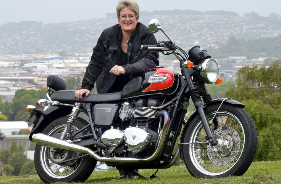 Dunedin City Council chief executive Dr Sue Bidrose stands with her retro-styled 2009 Triumph...