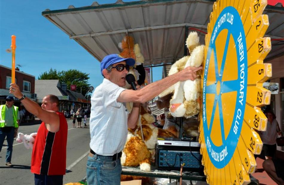 Bill Botting spins the Rotary Club of Taieri raffles wheel during the Mosgiel Christmas Market...