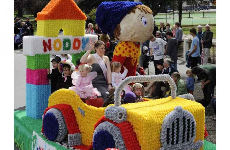 Princess Jess Linwood waves from the Alexandra Plunket Society's 'Noddy' float