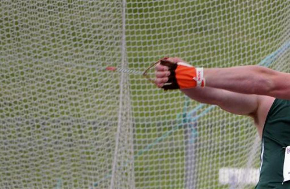 Matthew Bloxam (Orewa College) shows the form that won him the senior boys hammer throw at the...