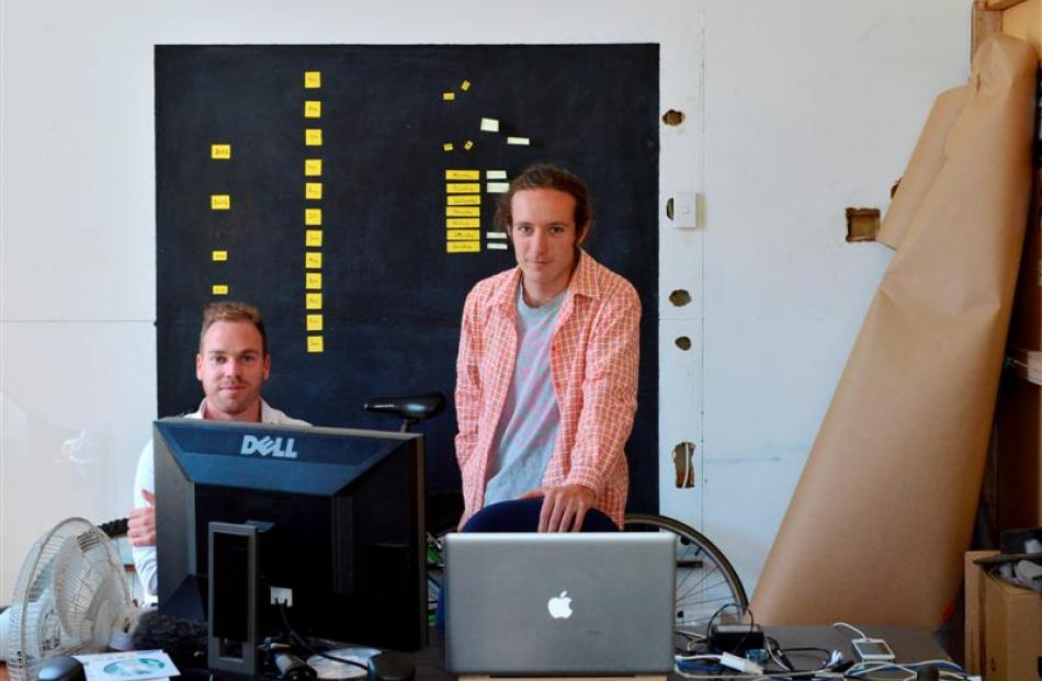 Blue Oyster Art Project Space director Jamie Hanton (left) watches artist Max Bellamy editing his...