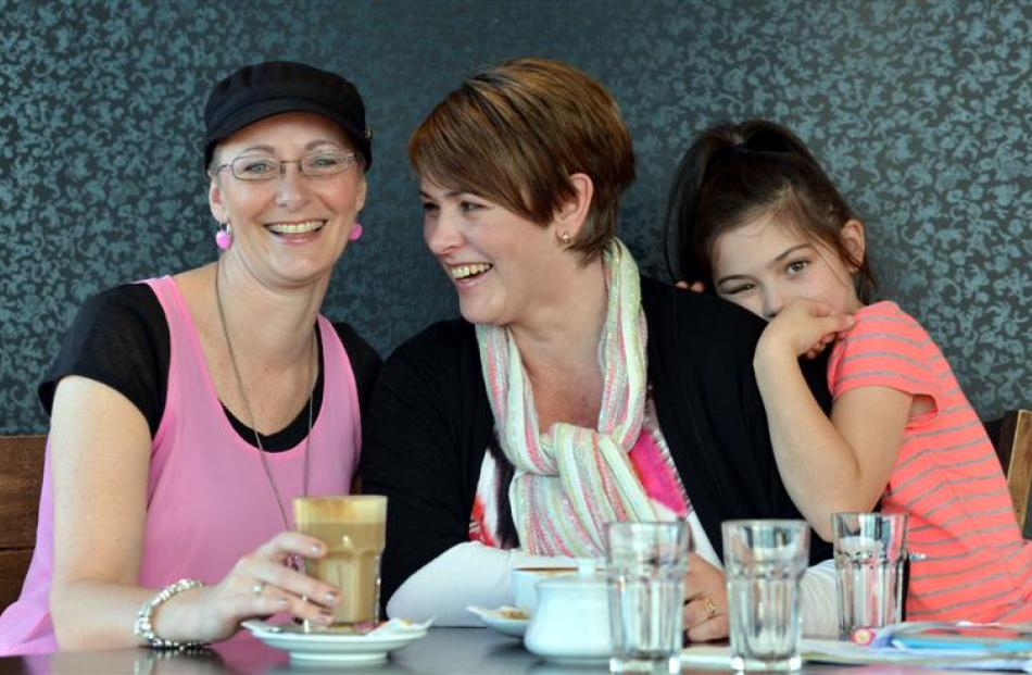 Breast cancer sufferer Delwyn Crawford (left) is supported by friend Nicola Donaldson whose...