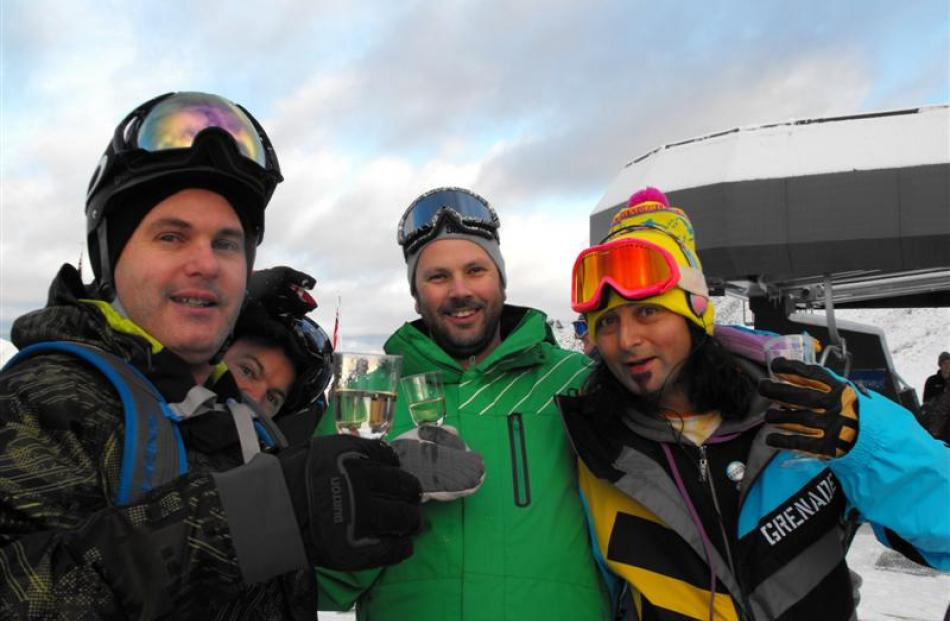 Brendon Cameron, Karl Hunt and Eddy Lecotey, all of Queenstown, make the most of the free bubbly...