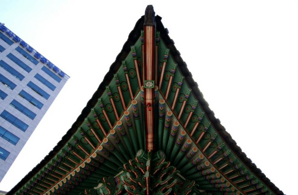 Brightly coloured, intricately patterned eaves of Deokhongjeon, the building used by Emperor...