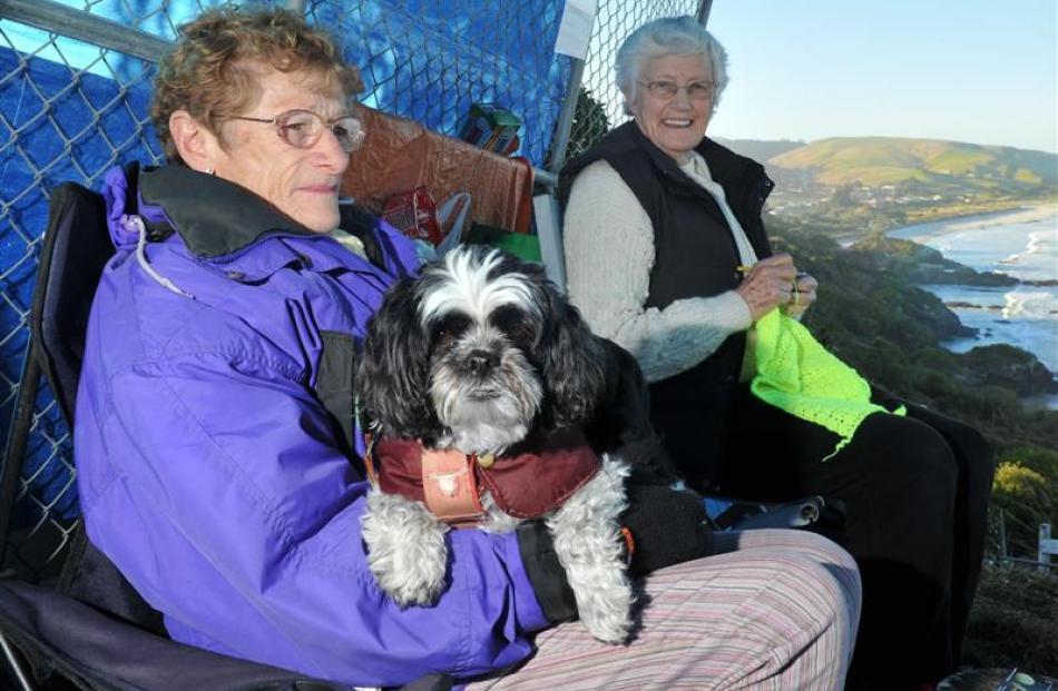 Brighton residents June McGregor (81, left), with her dog Penny, and Hazel Leslie (78) protest...