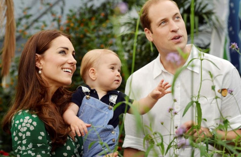 Britain's Catherine, Duchess of Cambridge, carries her son Prince George alongside Prince William...