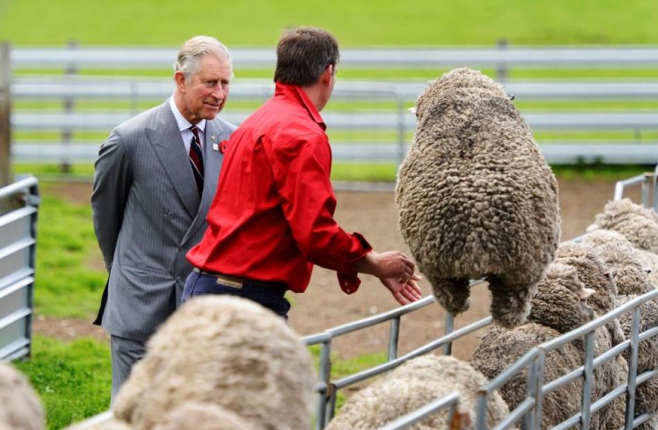 Prince Charles (L) chats with farm manager Brent Thornbury during a visit to the Leenavale Sheep...