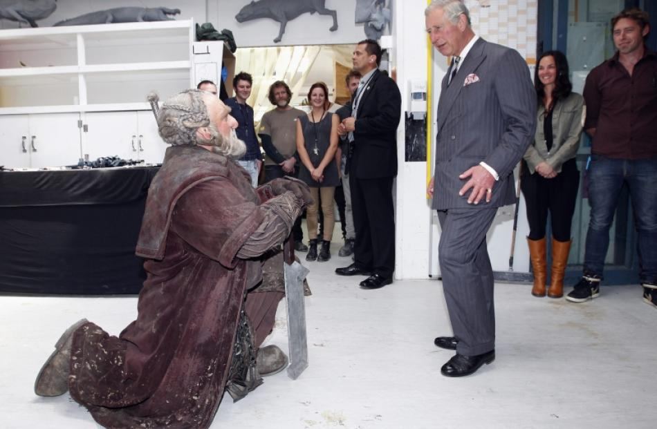 Britain's Prince Charles reacts as he meets Dori (left), a dwarf character from The Hobbit,...