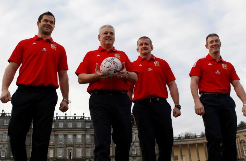 British and Irish Lions team head coach Warren Gatland (2ndL) walks his assistant coaches Andy...
