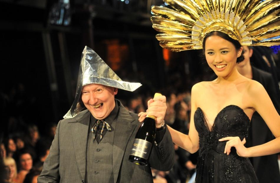 British milliner Stephen Jones wears a hat made from an Otago Daily Times and foil as he...