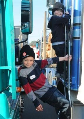 Brothers Phoenix (9) and Seth Clarkson (4)  were among hundreds of children who rode in a truck....