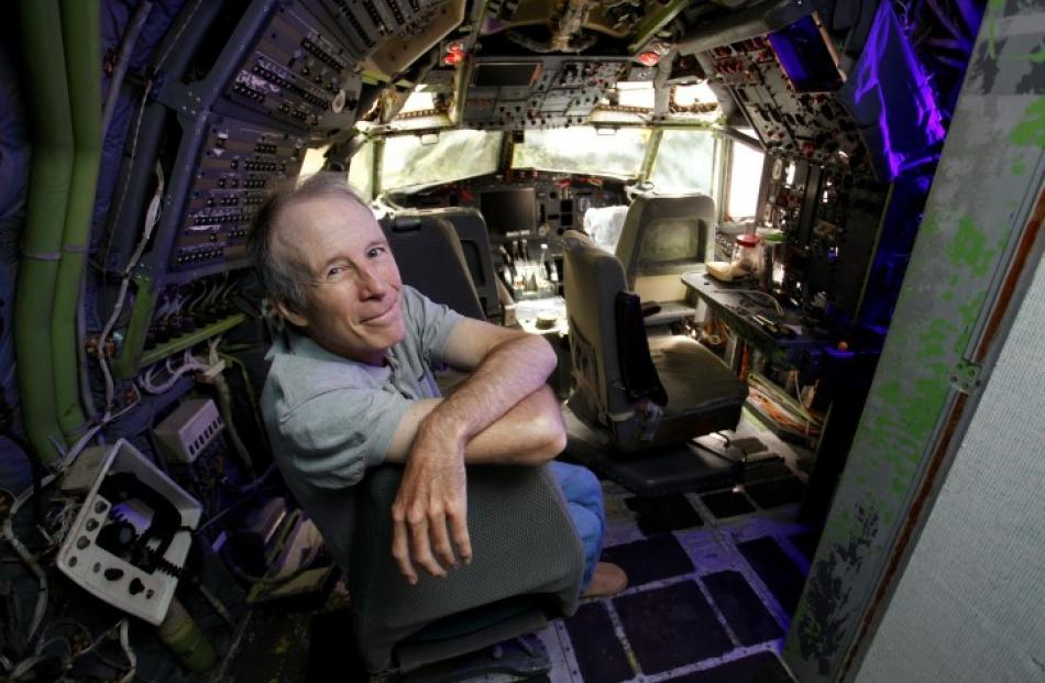 Bruce Campbell sits in the cockpit of his Boeing 727 home. REUTERS/Steve Dipaola