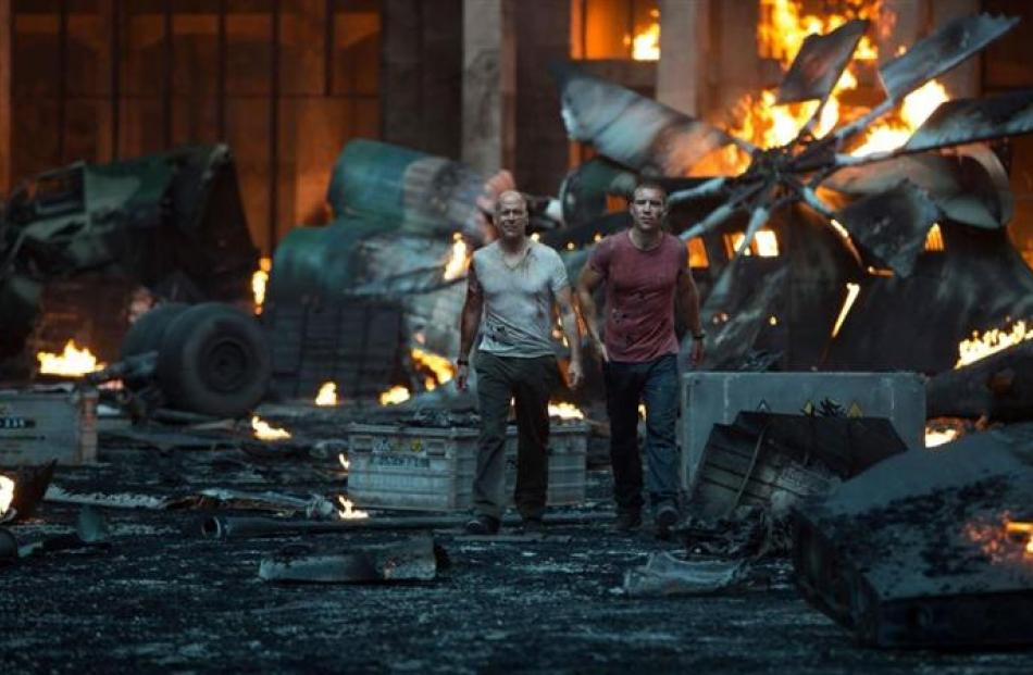 Bruce Willis and Jai Courtney in A Good Day to Die Hard.