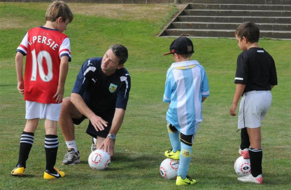 Burnley head of youth for Australasia Paul Wozny talks with (from left) Oliver Colloty (9),...