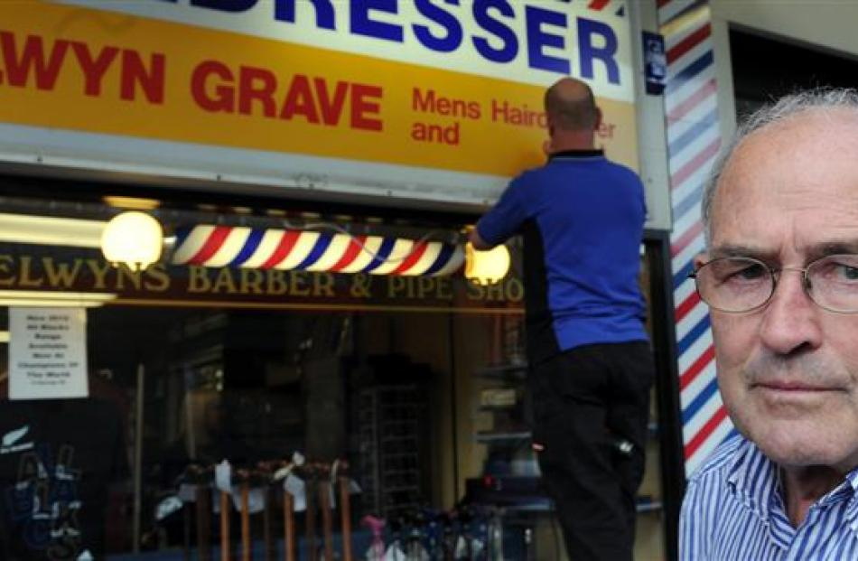 Business owner Selwyn Grave is less than impressed as Miller Studios signwriter Rob Harwood...