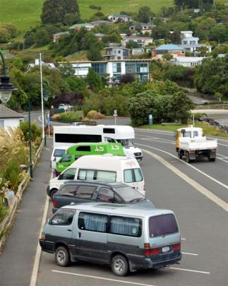 Campervans and vehicles in which people are sleeping line up at Macandrew Bay early yesterday in...