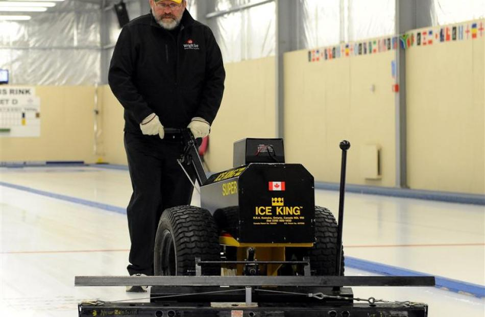 Canadian ice technician Doug Wright on the job at the Naseby Indoor Curling Rink this week. Photo...