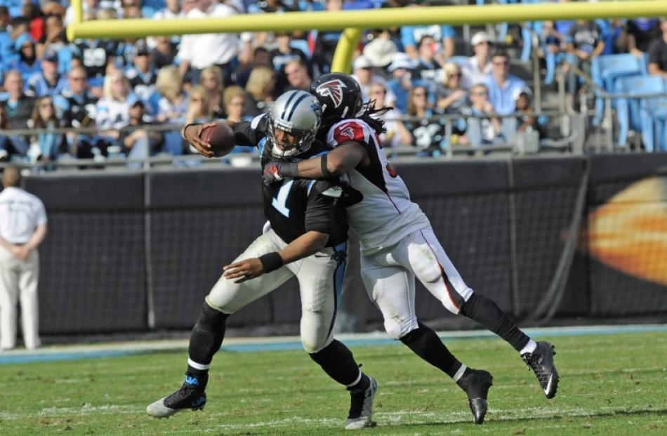 41e907dabe7 Carolina Panthers quarterback Cam Newton (1) rushes the ball and is tackled  by Atlanta