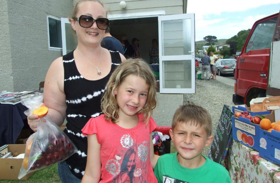 Carolyn, Emily (8), and Sean Reeves (6), all of Christchurch.