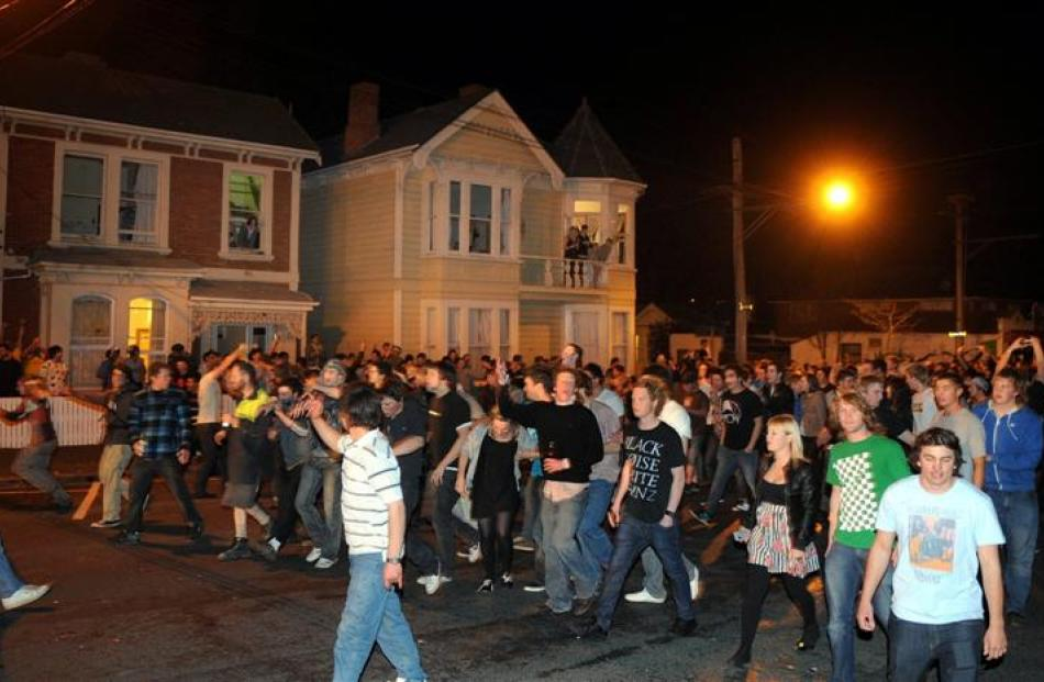 The crowd takes over in Castle St, Dunedin, last night, setting fires and pushing police out of...