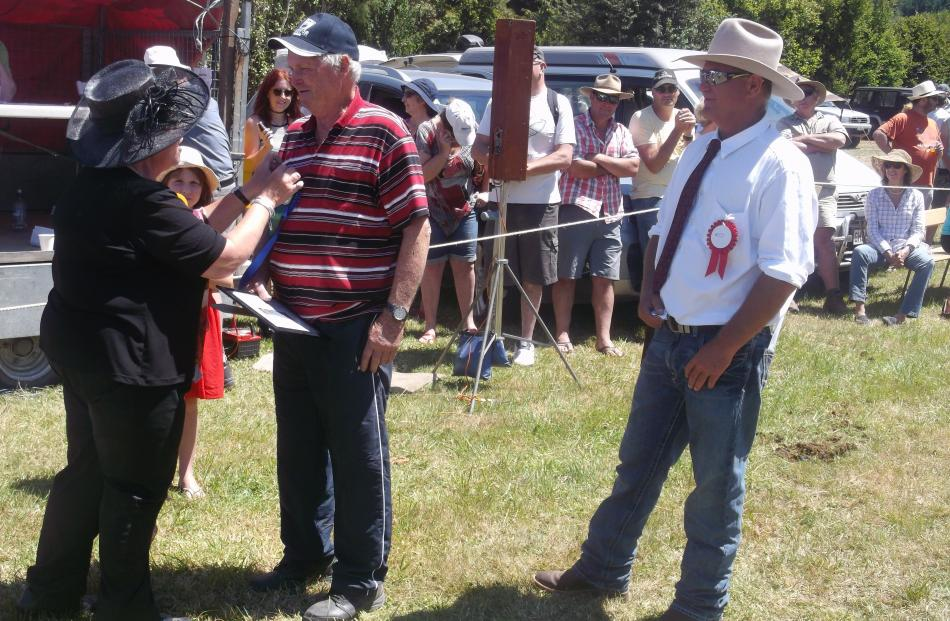 Duvauchelle A&P Show president Andrew Humm (right) watches on as Akaroa-Wairewa Community Board...