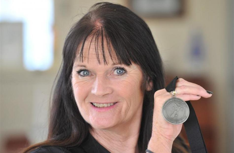 Cecilia Sullivan-Grant holds up the medal she was awarded as a Kiwibank Local Hero. Photo by...
