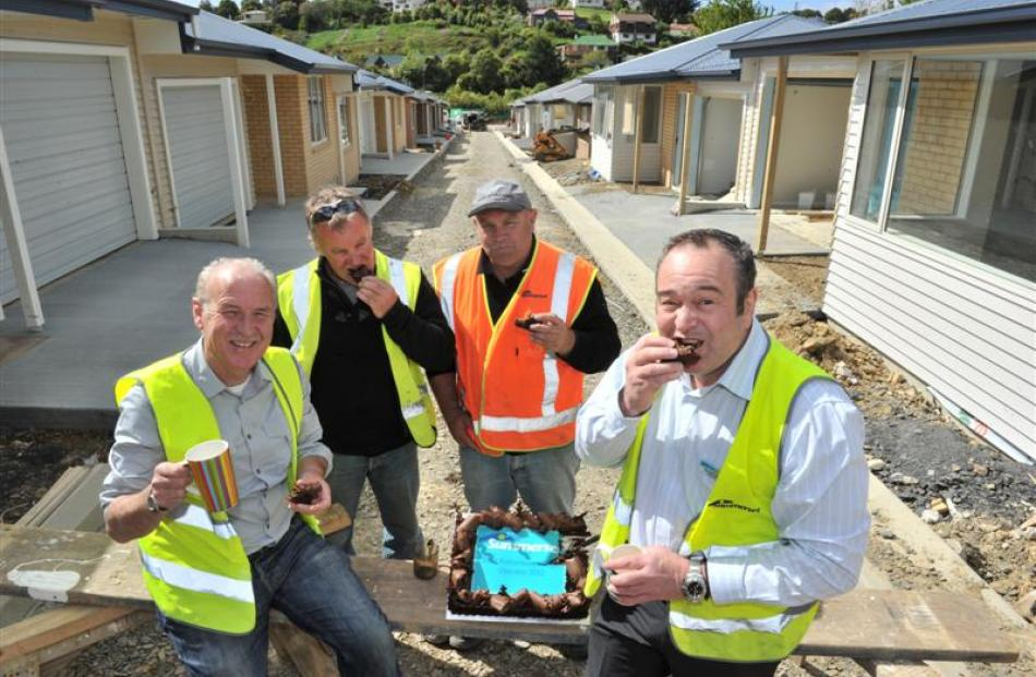 Celebrating an award and the construction of a retirement village in Dunedin being on schedule to...