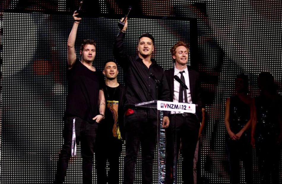 Celebrating their award for best single at the Vodafone New Zealand Music Awards at Vector Arena...
