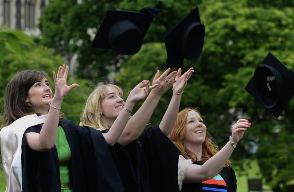 Celebrating their imminent graduation are  (from left) Aimee Burbery (22), Siobhan Kelly (22) and...