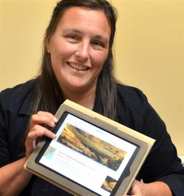 Centre for Science Communication lecturer Dr Jenny Rock tries out a new website on galaxiids,...