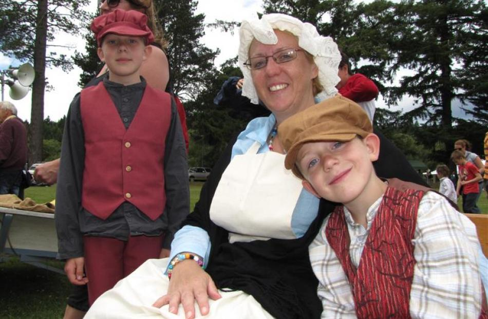 Charlie (8), Tracy and Harry (6) De Woeps, all of Naseby, enjoy the Victorian-themed Naseby...