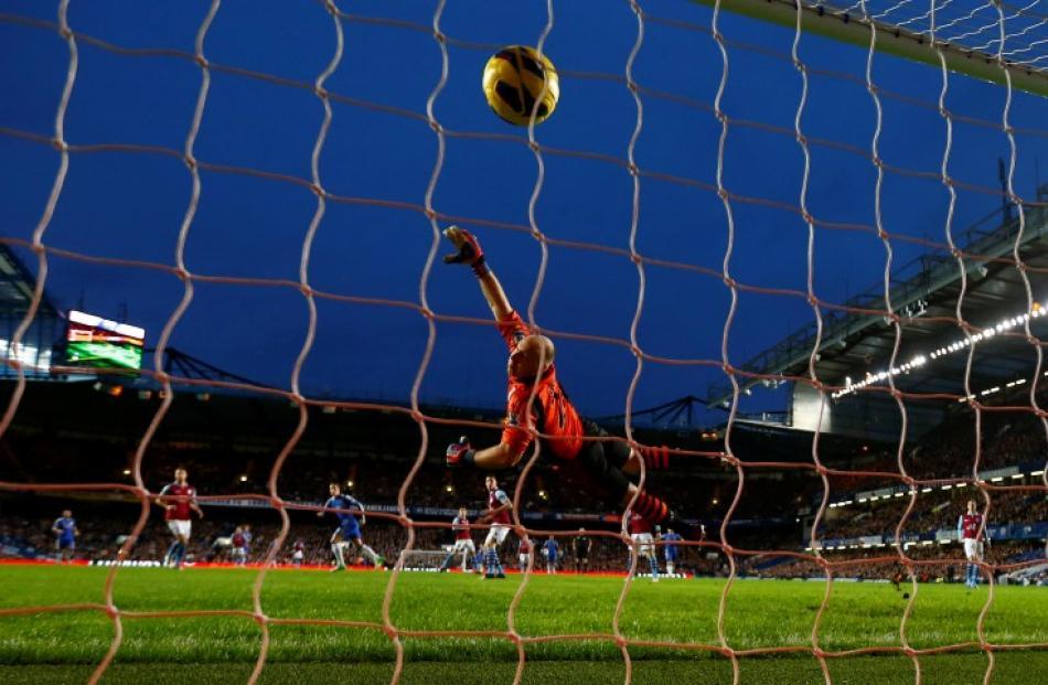 Chelsea's Fernando Torres (centre L) heads a goal past Aston Villa goalkeeper Brad Guzlan during...