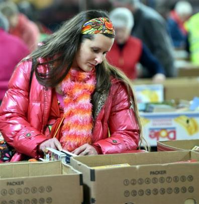 Cherie Royds, of Dunedin, browses at the Mosgiel Rotary Club's annual book sale. Photos by Gregor...
