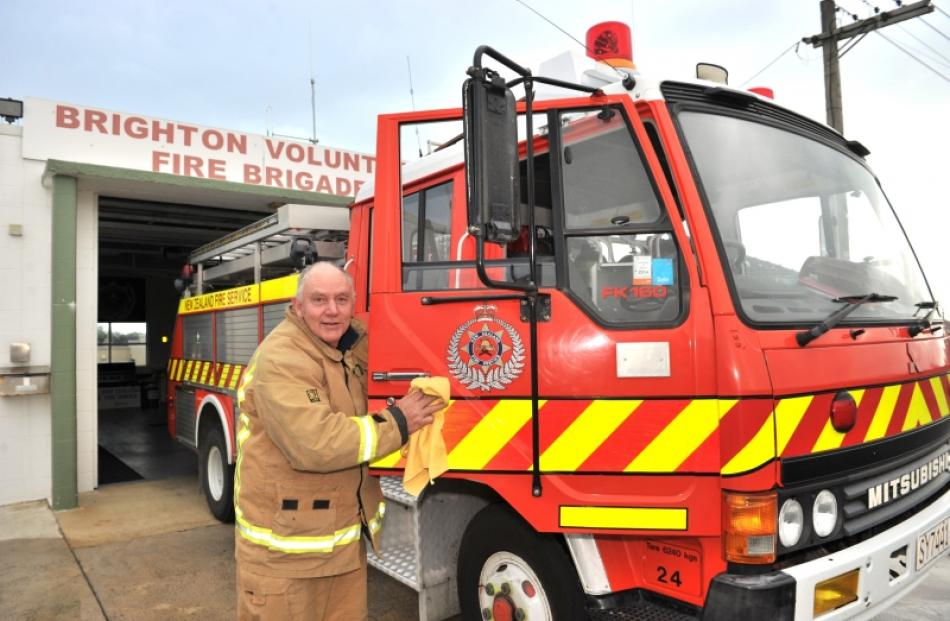 Chief fire officer Ian Armstrong polishes the brigade's fire engine in preparation for the...